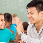 teacher providing positive feedback to a student