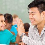 teacher providing positive feedback to a student