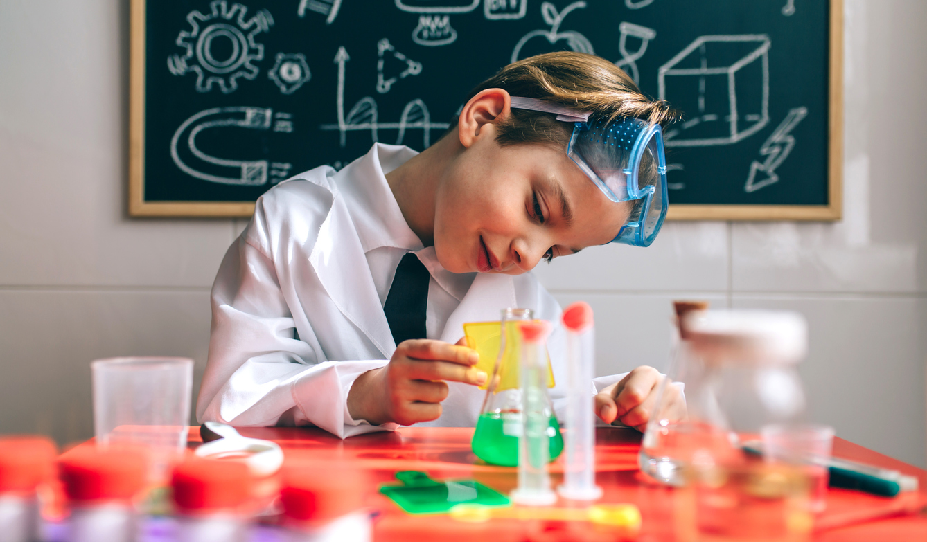 Boy playing with chemistry game