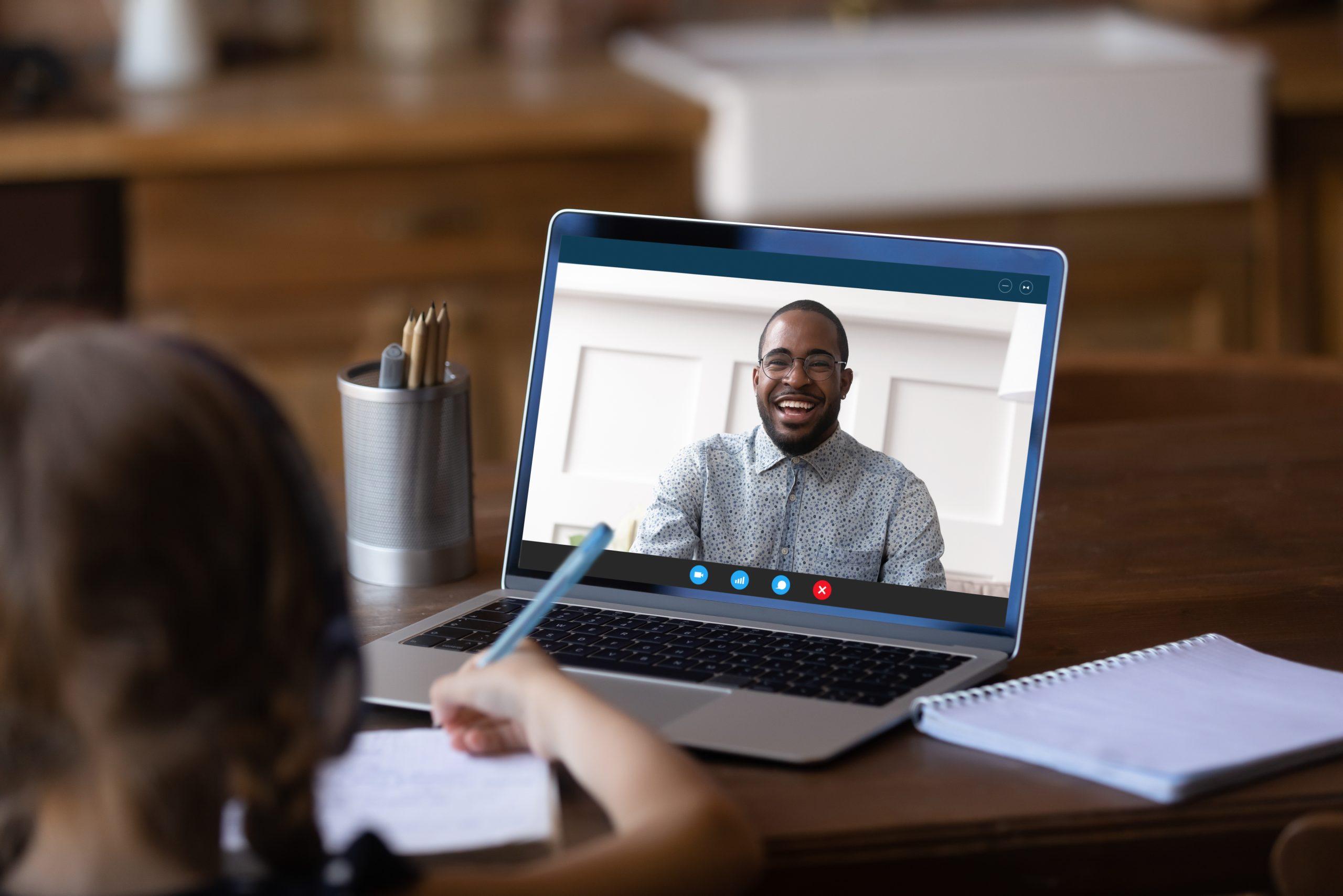 Georgia virtual teacher helping girl with lesson